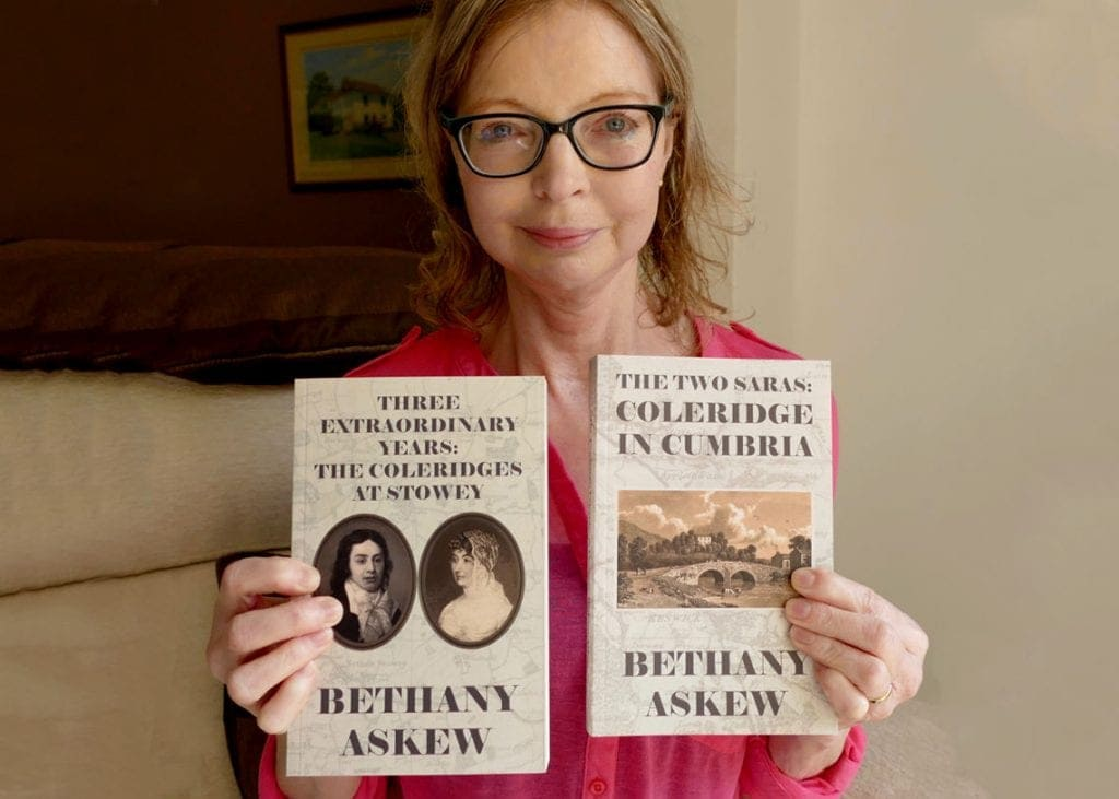 Author Bethany Askew holding her books 'Three Extraordinary Years: The Coleridges at Stowey' and 'The Two Saras: Coleridge in Cumbria'.