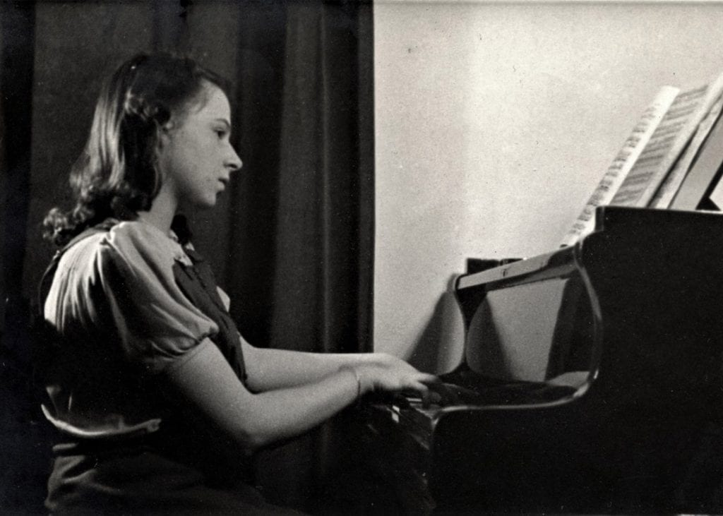 Judith playing the piano during her evacuation to Keswick during WW2