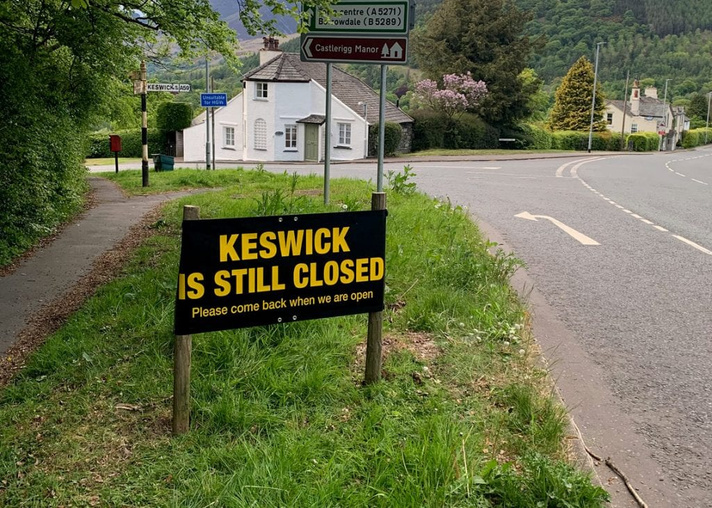 "The controversial ""Keswick is Still Closed"" signs were put up on the main roads into Keswick"