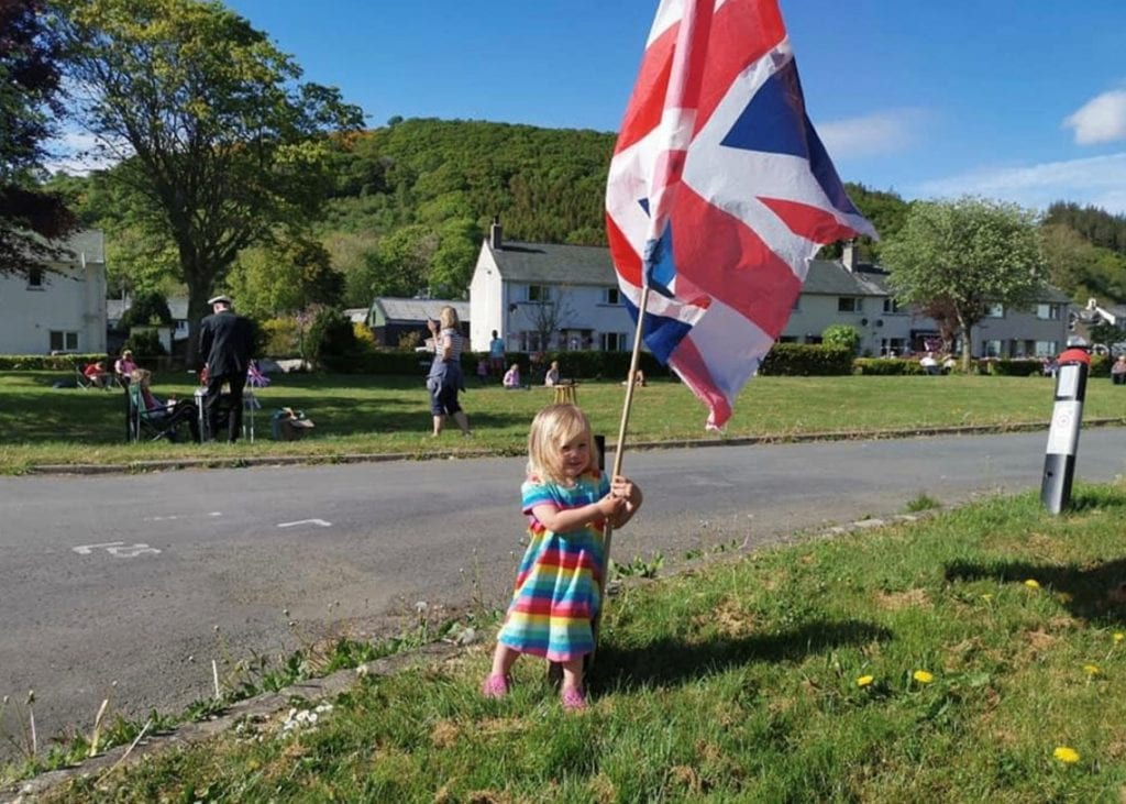 Willow Smith, 2, one of Bassenthwaite's youngest residents doing an impromptu flag wave as the bingo goes on in the background