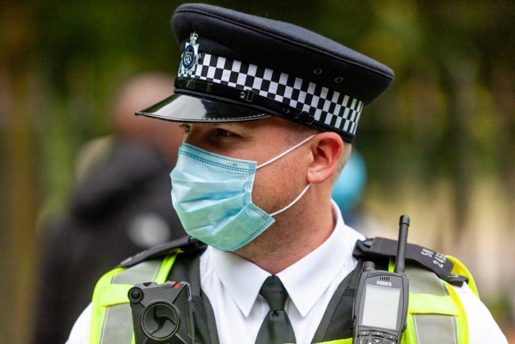 Police officer wearing facemask during coronavirus