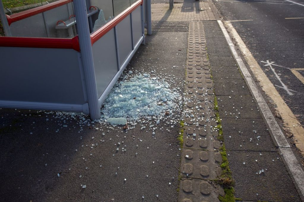 glass smashed in bus shelter
